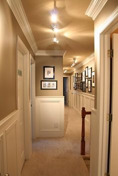hallway with wainscoting, crown molding and portrait gallery. Love the wall colors and contrast with the wainscoting Upstairs Hallway, Entry Hallway, Style Deco, My New Room, My Dream Home, Home Projects, Home Remodeling, Sweet Home, New Homes