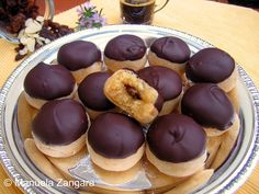 marzipan balls stuffed with rum-soaked raisins and dipped in chocolate, photo by Manuela Zangara