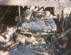 This was my father's 1965 convertible corvette.  He'd blown the engine before I was born and it sat in our garage.  As a child, I'd often climb behind the wheel and pretend to drive it.  In August of 1988, our garage caught fire and after, it looked like this.