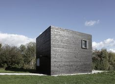 House in Normandy with blackened timber walls by Beckmann-N'Thépé Architectes