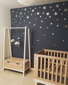 My little boy's starry night themed nursery scandiborn clouds mobile mamas and papas furniture hand painted with stencils with silver gold and white paints from Homebase