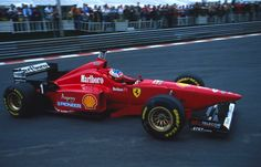 Michael Schumacher in his Ferrari F310 at La Source | 1996 Belgian Grand Prix
