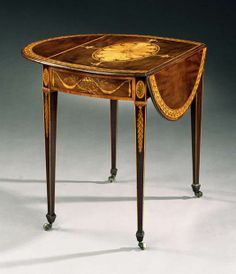 A GEORGE III HAREWOOD OVAL PEMBROKE TABLE BY GEORGE SIMSON A very fine late 18th century Adam period marquetry inlaid harewood Pembroke table by George Simson having a kingwood and tulipwood crossbanded top centred with a boxwood oval medallion with a berried laurel border, the frieze inlaid with palm fronds and swagged drapery; on square tapering legs headed by acanthus foliage with husked drops terminating in brass and leather castors.