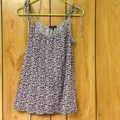 Floral tie tank Long so looks cute under a sweater but also transits into summer with leggings and sandals the perfect wardrobe staple. No wear at all Tops Tank Tops
