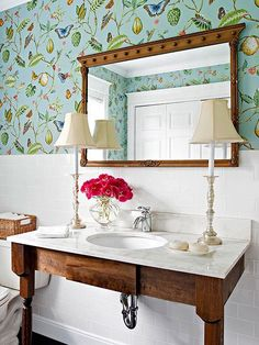 Pretty little powder room in floral design and white with delicate accents.