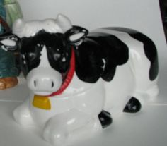 Kneeling Cow Cookie Jar