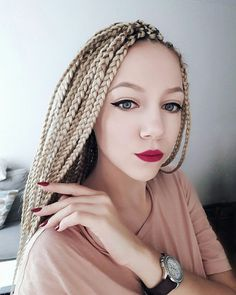 White girl with blonde box braids.  https://instagram.com/annabolshak