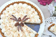Coconut & Date Cream Pie -- The perfect marriage of dates and toasted coconut on a graham cracker base...the sweet sour cream layer and whipped cream make this pie completely heavenly! Recipe at: http://crumbsandtales.com/coconut-date-cream-pie/