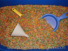 """""""Oooh! Add alphabet pasta to the rice table. I know the kids will LOVE finding the letters.""""  Sensory table idea"""