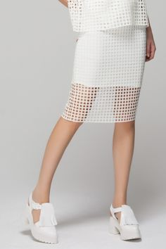 White cut out skirt with fringed platform sandals