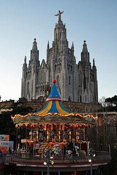 Tibidabo Church in Spain is juxtaposed against the Tibidabo carousel Barcelona City, Barcelona Catalonia, Oh The Places You'll Go, Places To Travel, Places To Visit, Hotel W, Spain And Portugal, Place Of Worship, Grand Tour