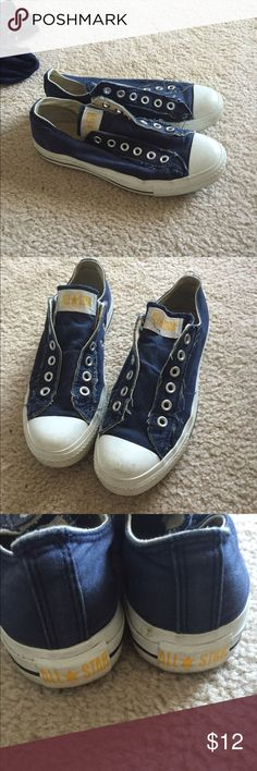 Converse tie-less Sneakers Navy sneakers without laces. They have elastic to make it easy to slip on and off. It has a distressed look. Good condition. 7.5 women's and 5.5 men's Converse Shoes Sneakers