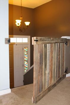 Dog Gate - Many months back, I approached our friend Jon with Pallet Rewind about making a baby gate for our house. You know, back when I assumed m. Diy Dog Gate, Diy Baby Gate, Diy Pallet Projects, Home Projects, Pallet Ideas, Wooden Baby Gates, Wooden Stair Gate, Pallet Gate, Baby Gate For Stairs