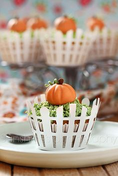 What sweetly adorable pumpkin topped autumn cupcakes. #Halloween #cupcakes #food #baking #decorated #fall #autumn #pumpkin