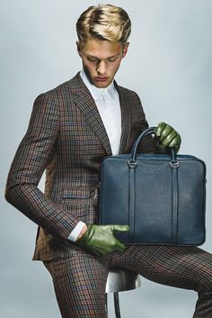 Bally's briefcase. Band of Outsiders' wool suit and Dior Homme's cotton shirt. Sermoneta gloves.