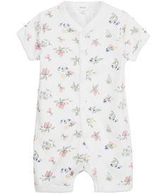 Newbie pyjamas med tryckt blommönster och tryckknappar.