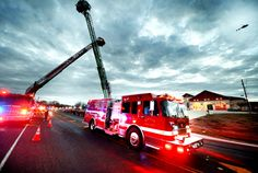 Bryan Fire Engine 5, carrying the remains of fallen firefighter and 32-year veteran Lt. Greg Pickard, passes Bryan Fire Station 5, where he worked, through an archway made by Bryan and College Station ladder trucks during a mile-long procession of fire and rescue vehicles from across Texas held in his honor down Villa Maria in Bryan Sunday evening. Eagle photo by Dave McDermand