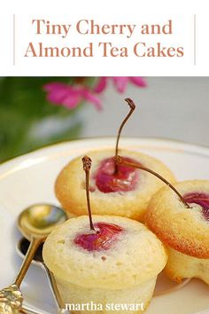 Each of these charming tea cakes is baked with a whole cherry inside -- stem, pit, and all. Be sure to warn guests about the pits, or remove the stems and pits before baking. Cherry And Almond Cake, Almond Tea, Almond Cakes, Bakery Recipes, Cupcake Recipes, Dessert Recipes, Just Desserts, Delicious Desserts, Muffins