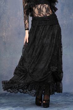 This gorgeous gothic skirt by Dark in Love is made from a layer of black lace with embroidered flower detail. The skirt is pinned up with lace roses.