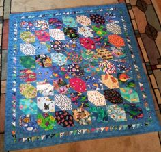 """I spy"" quilts are so good for toddlers and Barbara's combines that ""sleepy-time blue"" with colorful fabrics to make a very lovely work of art."