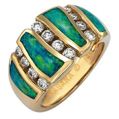 GRCF642X - This ring is inlaid with Opal, set in 14k yellow gold and accented with diamonds. Total weight of diamonds is .47ct SI1 quality and G-H color.