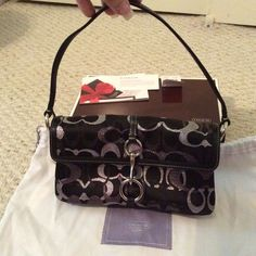 Coach mad lrx flap handbag Beautiful evening bag, never used, perfect condition. Black bag w/silver, charcoal and black signature C's. Comes with dust bag! Coach Bags