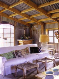 Interesting....(slightly rusty) corrugated metal for interior walls and ceiling? Amber Interiors