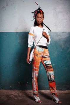 Love these 'tribal' Gwen Stefani designed pants - brown, orange, pale turquoise and white mixed swipe stripes with elastic band waist in dark brown. Shoes not so much. From her L.A.M.B. Spring collection @ Fashion Week in New York. (in Sept 2014)