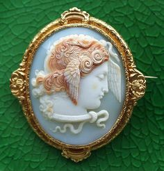 Medusa      Materials: shell, 18ct gold (unmarked)  Size of the cameo: 2 x 1 1/4  Size of the frame: 2 9 /16 x 2 1/4  Date and origin: England, ca 1820-30.  Condition: the cameo is 100% Mint.  The frame is 100% mint on the front side. Unnoticeable dent on the back side.  The background shows a hairline by origin (not a crack or a stress line).