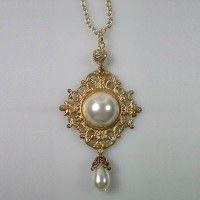 Anne Boleyn gold brooch necklace.                                                                                                                                                                                 More