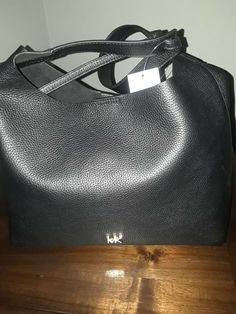 bfa50d103e6754 Michael Kors Junie Medium Hobo Leather Bag, brand new with tags and dust bag .
