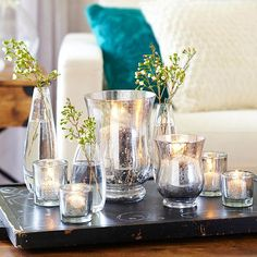 Faux Mercury Glass Get the look of mercury glass with this simple DIY technique. You will need: Glass votive or vase Spray bottle filled with water Krylon Looking Glass Mirror Like spray paint Newspaper or paper plate