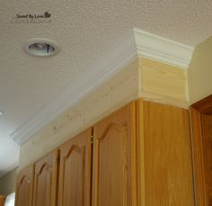 take cabinets to ceiling with crown moulding! So important before painting to give the kitchen an updated look!