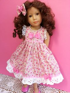 Laura Kidz n Cats in a ditsy pink floral dress trimmed with ric-rac, lace & bows