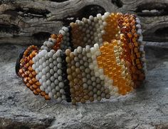 As the sun sets in the southwest, the mesas outline the horizon with a parade of beauty and awe! The inspiring beaded Owyhee picture jasper cabochon bracelet is unique and would be a lovely accessory for any eclectically conscious woman. Its a passion working with seed beads, using a needle and thread to create something wonderful, one bead at a time. There are no actual patterns, it all happens rather organically color and inspiration drives the whole process. This bracelet is 1 1/4 inch…