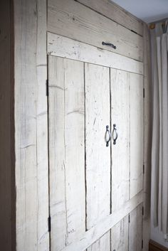 rustic built in bedroom wardrobe made from reclaimed and repurposed materials.