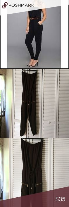 "Michael Kors strapless jumpsuit🌹 Brown with gold hardware🌹 drawstring waist🌹 side slide pockets and zip pockets 🌹stretch ankles 🌹material 100% rayon🌹stretch top🌹lying flat across top measures 13"" 🌹top to bottom of leg measures approx  48"" 🌹 jumpsuit is very similar to pic 1 and pic 7 in style MICHAEL Michael Kors Other"