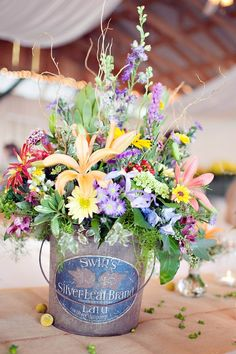 I have to do this wedding in a flower vase tin bucket style like this!