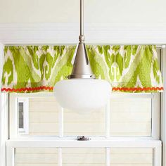 Use a tension rod and leftover fabric to make a simple window treatment. Sew or use iron-on hem tape to create a small rod pocket at the top and hem the bottom. Add decorative trim for extra pizazz./