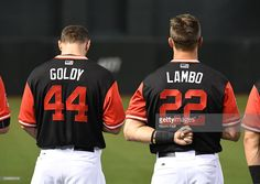 Jake Lamb #22 and Paul Goldschmidt #44 of the Arizona Diamondbacks stand along the left field line during the national anthem against the San Francisco Giants at Chase Field on August 25, 2017 in Phoenix, Arizona.
