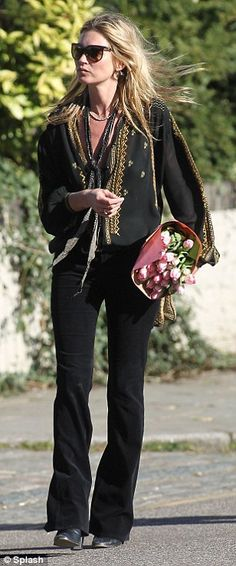 Sheer delight: The model wore a see-through black and gold blouse and black jeans