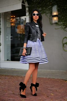 Cropped leather jacket, striped skirt and Aminah Abdul Jillil bow pumps for stylish look