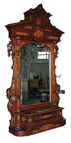 Storage space attached to mirror Antique Renaissance Revival Carved Rosewood Hall Piece