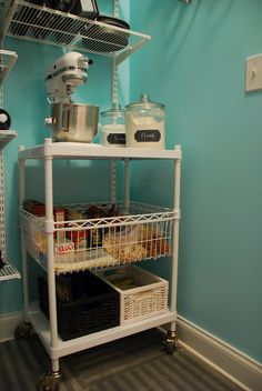Heavy kitchen equipment can be placed on a rolling cart or microwave station so 1) it does not take up limited counter space, 2) it does not need to be lifted or moved (which can be difficult with larger heavier appliances), 3)  it can be rolled into a pantry or closet when not in use, and rolled out for baking.    Site has other pantry makeover ideas