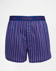 Boxershorts von Calvin Klein Webstoff elastischer Bund Markenlogo einzelner Zierknopf schmale Passform, sitzt eng am Körper Maschinenwäsche 100% Baumwolle