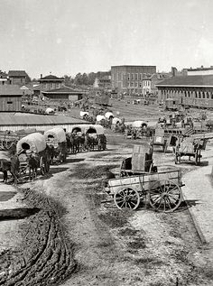 Atlanta, 1864. Federal Army wagons at railroad depot.