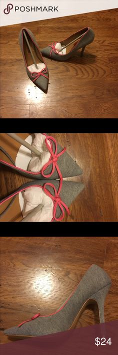 Brand New Heels Gray Pink Bow 8.5 Brand New in box. High Heels. Heather Gray with pink bow! Newport News Shoes Heels