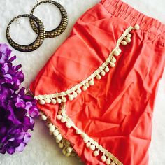 Final price  🎯Pom Pom shorts -coral Beautiful solid color Pom Pom shorts in small Medium, large and extra large .100% polyester . 🚫This listing is for color Coral  . Please see other listing for other colors shown (black and mint ) . Shorts