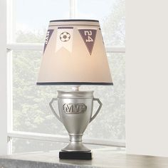 The Varsity Lamp was designed exclusively for Babies R Us by Lambs &…
