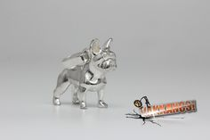 The first Vakkancs French Bulldog were made in 2011. The Creator is Katalin Kurta jeweller, teh technical leader, and one of the founder owners of the Ékszergyár Kft. (Jewelry Factory Ltd.).  All Vakkancs products are made in Hungary, they are handmade, and they have to pass a painstaking quality control before sale.  Material: solid sterling silver (925) Size: cc 3 cm x 2,5 cm Weight: cc 19 gramm  * Hungarian Hallmark * Certificate, signed by the artist * Numbered product